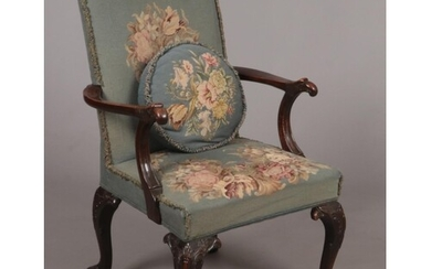 A mahogany Gainsborough type armchair in 18th century style....