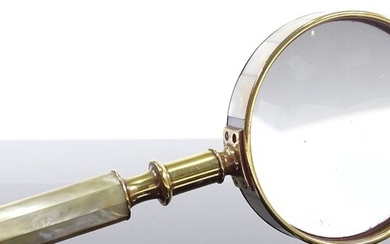 A mother-of-pearl and brass-mounted magnifying glass, length...
