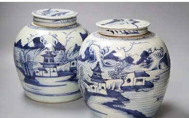 A pair of 18th century Chinese blue and white jars and cover...