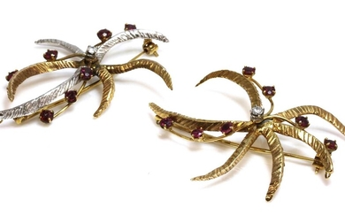 A pair of 9ct two colour gold, diamond and ruby star/flower brooches, c.1970