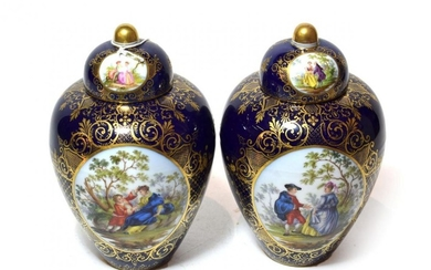 A pair of Dresden vases and covers, central painted panels...