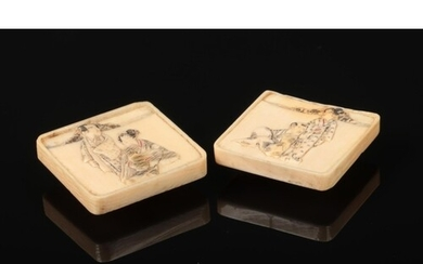 A pair of Japanese Meiji period carved ivory square formed b...