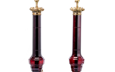 A pair of brass mounted ruby glass lamp bases