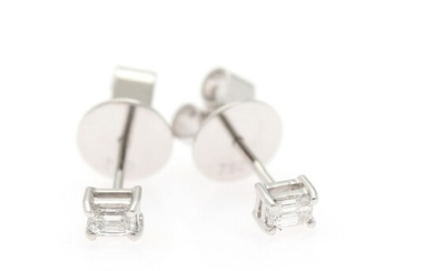 A pair of diamond ear studs each set with an emerald-cut diamond weighing a total of app. 0.21 ct., mounted in 18k white gold. (2)