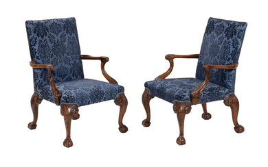 A pair of walnut and upholstered open armchairs