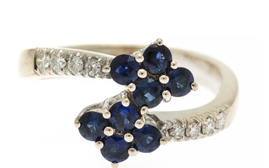A sapphire and diamond ring set with eight sapphires and ten brilliant-cut diamonds, mounted in 18k white gold. Size 56.