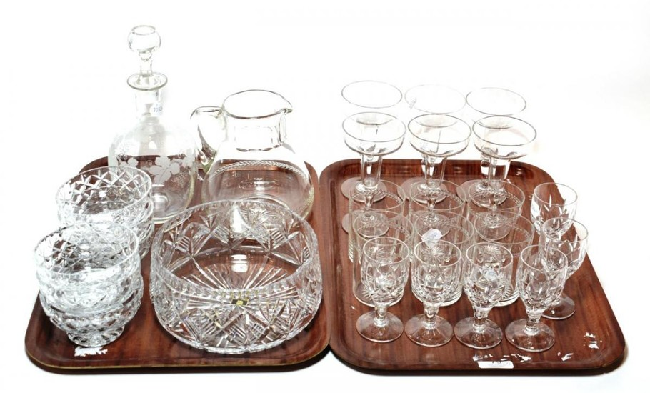 A set of six stemmed glasses; a water jug and...