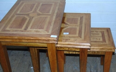 A set of three quality graduated oak side tables with applie...