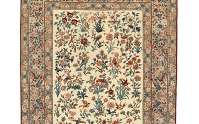 A signed Seirafian Isfahan rug, Persia. All over design of roses and bird motifs on an ivory field. C. 1960. 220×148 cm.