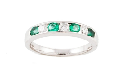 AN EMERALD AND DIAMOND HALF ETERNITY RING, with emeralds of ...