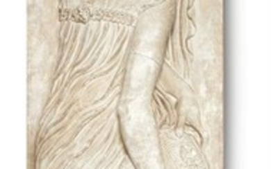 AN OVER-LIFE SIZE PLASTER RELIEF OF A NYMPH
