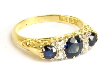 An 18ct yellow gold diamond and sapphire ring, the...