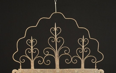 An 18th Century Wrought Iron Wall Rack fitted with five hooks on a horizontal bar surmounted by scro