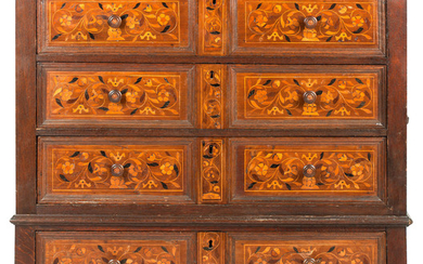 An oak and floral marquetry inlaid chest of drawers