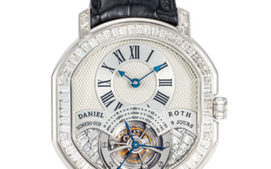 DANIEL ROTH. A VERY FINE AND RARE 18K WHITE GOLD AND BAGUETTE-CUT DIAMOND-SET BARREL-SHAPED DOUBLE-DIALED TOURBILLON WRISTWATCH WITH DATE AND 8 DAY POWER RESERVE, SIGNED DANIEL ROTH, REGULATEUR TOURBILLON MODEL, REF. 197.X.60, CASE NO. 009, CIRCA 1995