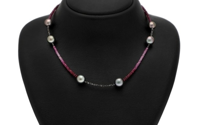 Hartmann's: A pearl, ruby and diamond necklace set with numerous cultured Tahiti pearls, and ruby and diamond roundels weighing a total of app. 5.5 ct.