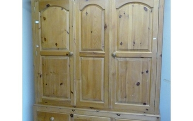 Large modern triple door pine wardrobe with three short and ...