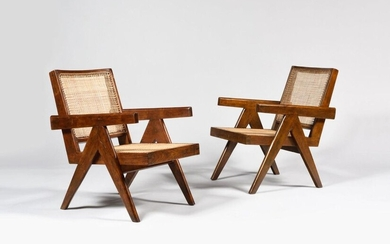 "PIERRE JEANNERET (1896-1967) ""Easy chairs"" Chandigarh, circa 1955 Pair of profiled and varnished wooden armchairs, backrests and seats rebuilt to new Height: 76 cm - Width: 53.5 cm - Depth: 65 cm Bibliography: Le Corbusier Pierre Jeanneret: The Indian..."