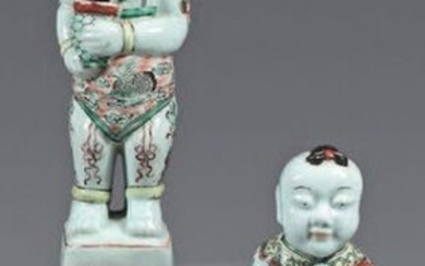 Pair of Chinese porcelain Ho-Ho. Kangxi (1662-1722). Represented standing on a base, dressed in a loincloth, decorated with enamels of the Green Family of bird, precious objects and friezes of mantling, grit and very small wear.