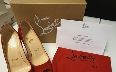 Pair of Louboutin red high heeled court shoes with open toes...