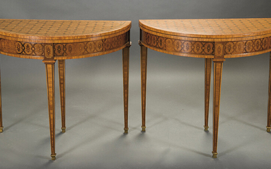 Pair of crescent-moon console tables in marquetry, ff. s. XIX. In fruit wood and stained. With a drawer in the waist and a green felt mat. Measurements: 74x44x87 cm. Exit: 750uros. (124.790 Ptas.)