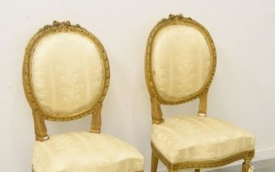 Pair of gilded Louis XVI style chairs