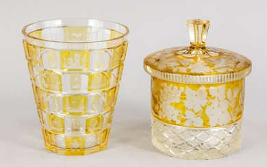 Vase and lidded box, 20th century, vase with conical body, box, cylindrical shape with domed lid, each clear glass, partly overlaid with yellow, with cut decor, h. up to 16 cm