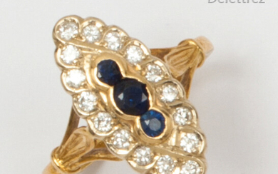 "Yellow gold ""Navette"" ring, set with three sapphires in a ring of brilliant-cut diamonds. Finger size: 54. Rough weight: 4.3g."