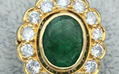 Yellow gold ring centered with an oval emerald...