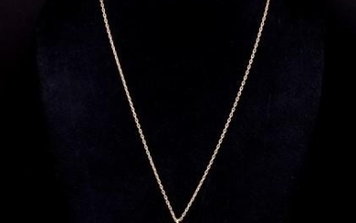18ct yellow gold pendant and gold chain depicting Fortuna an...