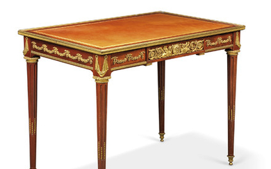 A FRENCH ORMOLU-MOUNTED MAHOGANY WRITING TABLE, IN THE MANNER OF JEAN-HENRI RIESENER, LATE 19TH CENTURY