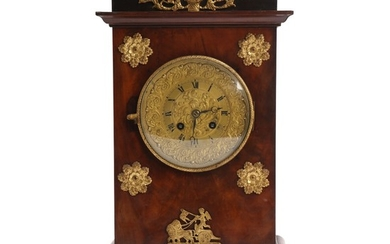 A 19th century Charles X mantel clock in a mahogany case. H. 39.5 cm.
