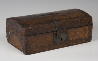 A 19th century Tudor Revival tooled leather domed-top box with handcrafted ironwork and paper-lined