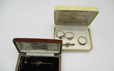 A 9ct gold and gold coloured metal to include three rings an...