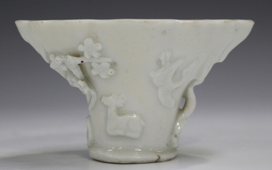 A Chinese blanc-de-Chine porcelain libation cup, probably Kangxi period, of traditional horn form, m