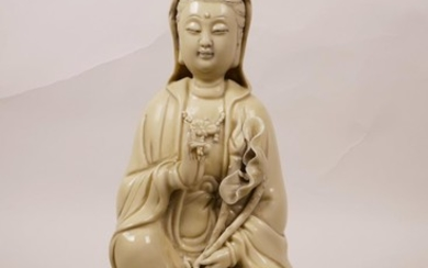 A Chinese blanc de chine Quan Yin seated on a lotus throne, ...