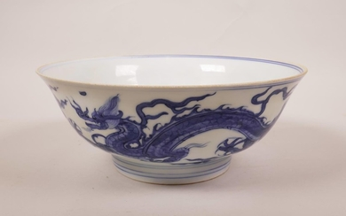 A Chinese blue and white porcelain dish decorated with drago...