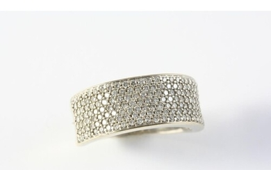 A DIAMOND HALF HOOP RING set to one side with seven rows of ...