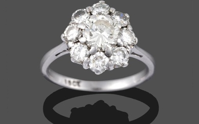 A Diamond Cluster Ring, a round brilliant cut diamond within...