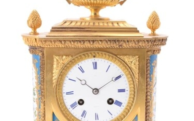 A French Sevres style porcelain and gilt metal mantel clock