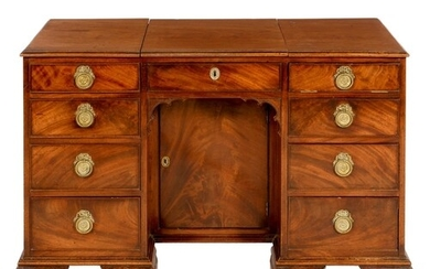 A GEORGE III MAHOGANY KNEEHOLE DRESSING TABLE the top with ...