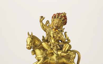 A GILT-BRONZE FIGURE OF PALDEN LHAMO, QIANLONG INCISED SEVEN-CHARACTER MARK AND OF THE PERIOD (1736-1795)