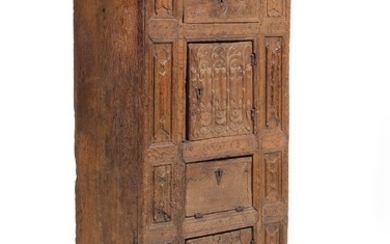 A Gothic oak cabinet, richly carved with folding work and foliage, front with two doors, leaf and drawer. 15th-16th century. H. 169. W. 75. D. 46 cm.
