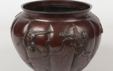 A Japanese Meiji period bronze lobed planter decorated in re...