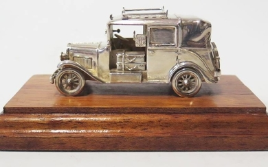 A Modern Silver Model of an Old London Taxi, base 13cm long,...