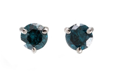 A PAIR OF BLUE DIAMOND STUD EARRINGS, mounted in white gold....