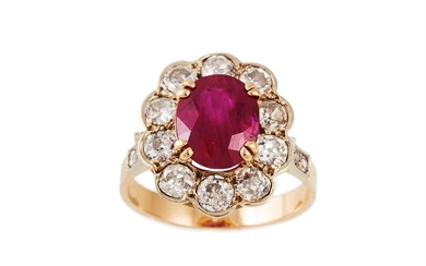 A RUBY AND DIAMOND CLUSTER RING, mounted in gold. Size M. Es...