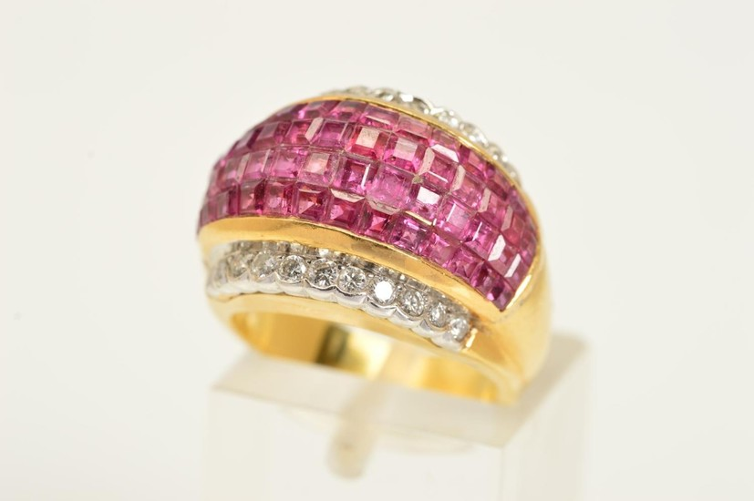 A RUBY AND DIAMOND DRESS RING, the central domed panel compr...
