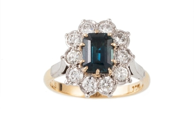 A SAPPHIRE AND DIAMOND CLUSTER RING, the central sapphire su...