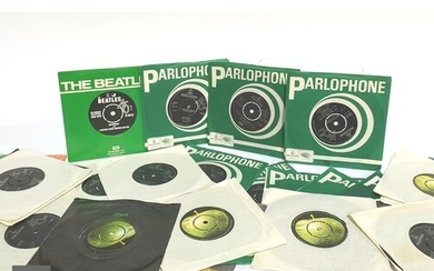 A collection of Beatles 7 inch singles, mostly later issues,...